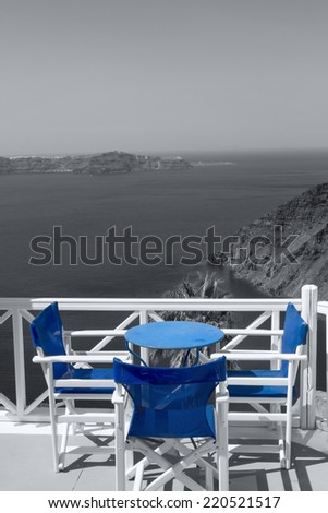 Table on terrace overlooking sea - stock photo