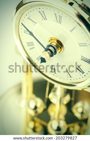Table period clock with oscillating mechanism - stock photo