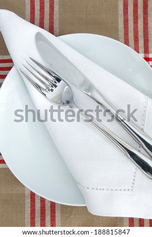 Table Place setting with knife and fork and linen  - stock photo