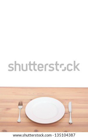 table plate, knife and fork - stock photo