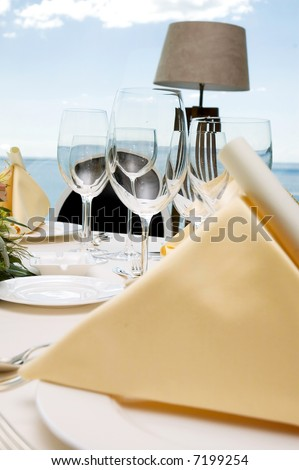 Table preparing for after wedding ceremony diner in luxury hotel's restaurant. - stock photo