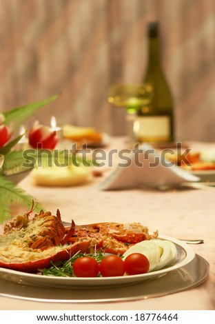 Table ready to serve an elegant lobster dinner - stock photo