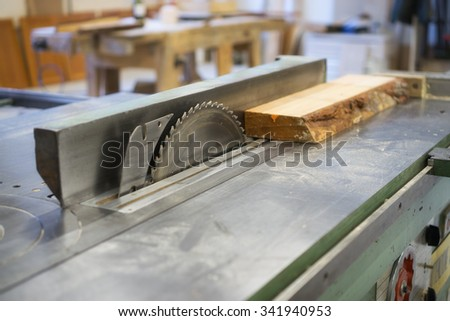 table saw in workshop - stock photo