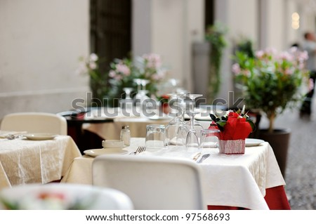 Table set for an event party or dinner outdoors - stock photo