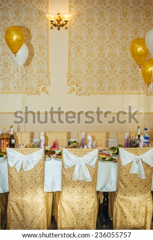 Table set for an event party or wedding reception. decorated wedding table in the restaurant. Wedding ornament from balloons. Valentines day dinner with holiday elegant heart ornaments. wedding arch.  - stock photo