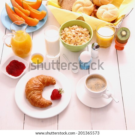Table set for breakfast with healthy food, top view - stock photo