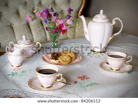 Table set for coffee with old style china - stock photo