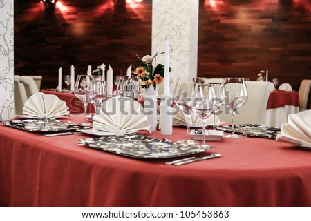 Table set for dinner in modern restaurant - stock photo