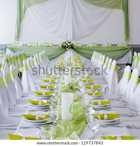 table set for wedding dinner decorated with flowers - stock photo