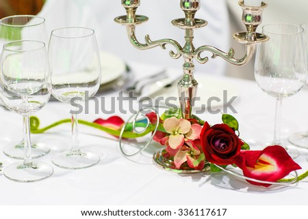 Table set  for wedding or event party with rose and berry decoration. Elegant decoration. - stock photo