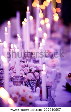 Table set for wedding reception with candles - stock photo