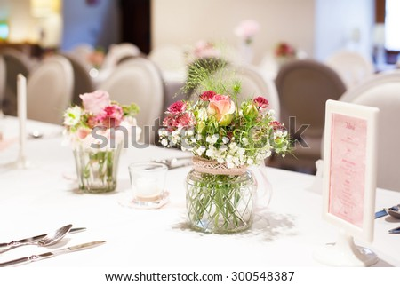 Table set in soft pink and white for wedding or event party. Luxury decoration for celebration, with give away for guests - stock photo