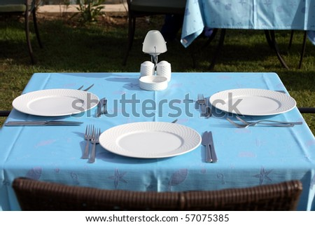 table set on a restaurant, outdoor - stock photo