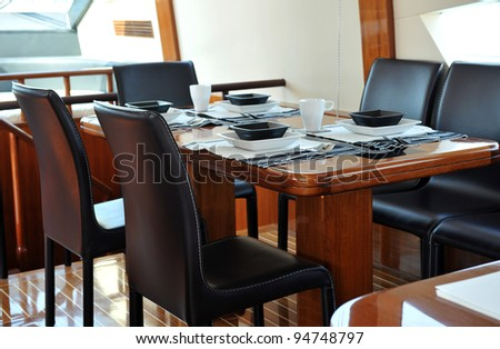 Table setting at a luxury yacht. - stock photo
