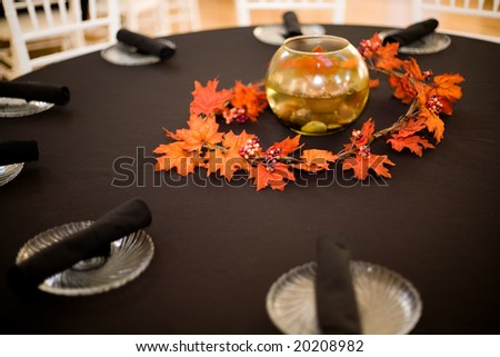 table setting at a wedding - with a fall theme - stock photo