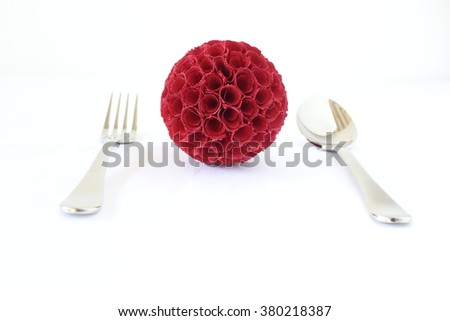 Table setting. Cutlery, fork, spoon, decorated with red ball.  - stock photo