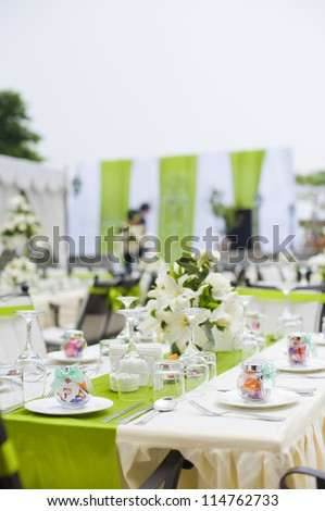 Table setting for a outdoor wedding with flowers - stock photo
