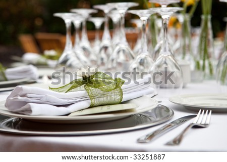 Table setting for a wedding or dinner event with flowers - stock photo