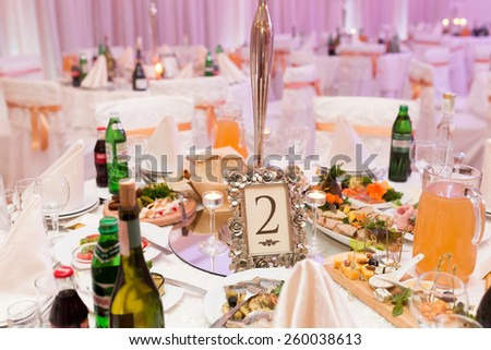 Table setting for an wedding reception in pink color - stock photo