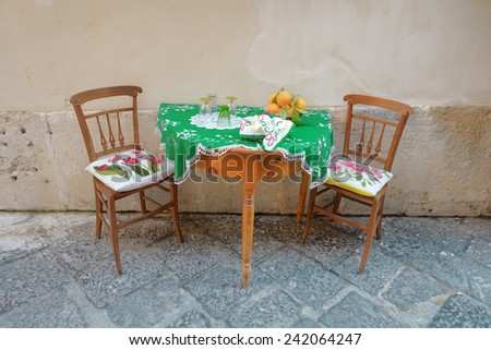 table setting for two in Ortigia Old Town of Siracusa, Sicily - stock photo
