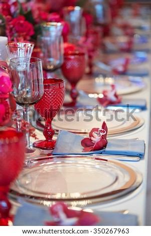 Table setting set with candles and flowers - stock photo