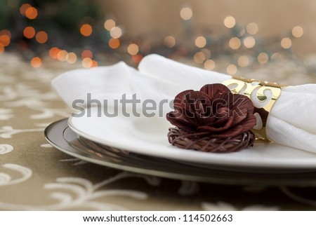 Table setting with a Christmas light reflection background - stock photo