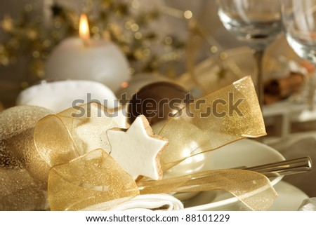 Table setting with Christmas decorations and candle light - stock photo