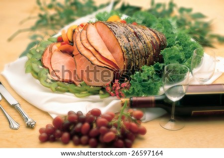 table setting with delicious whole baked sliced ham - stock photo