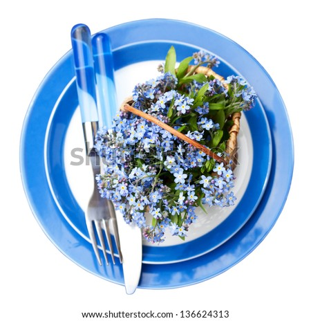 Table Setting with Forgetmenot Flowers - stock photo