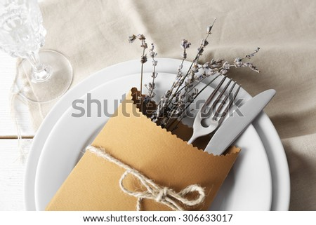 Table setting with lavender flowers, close-up - stock photo