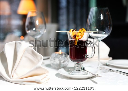 table setting with mulled wine and candle - stock photo