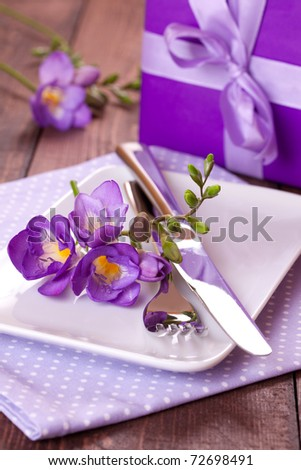 table setting with present for mothers day - stock photo