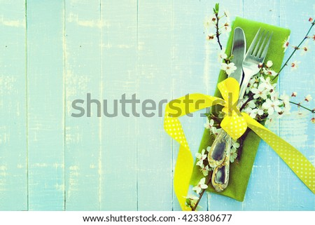 Table setting with spring flowers and cutlery. Holidays background - stock photo