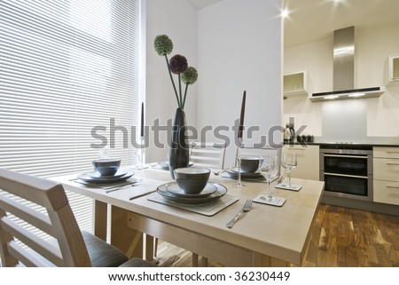 table setup with kitchen view - stock photo