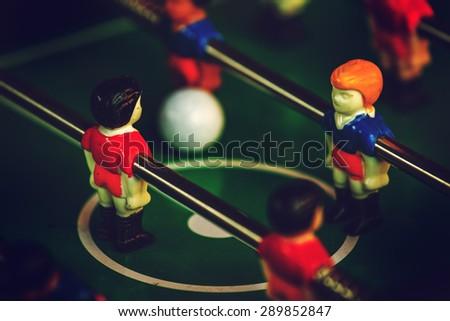 Table Soccer or Foosball Kicker Game, Selective Focus, Retro Tone Effect - stock photo