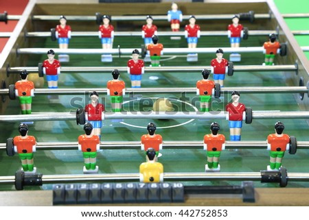 Table Soccer or Football Kicker Game with Player Figures. - stock photo