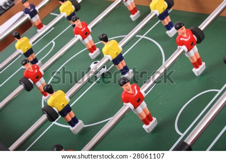 table soccer with players and a ball - stock photo