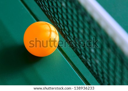 Table tennis ball on table with net - stock photo