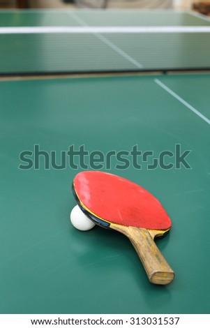 Table tennis bat and ball  - stock photo