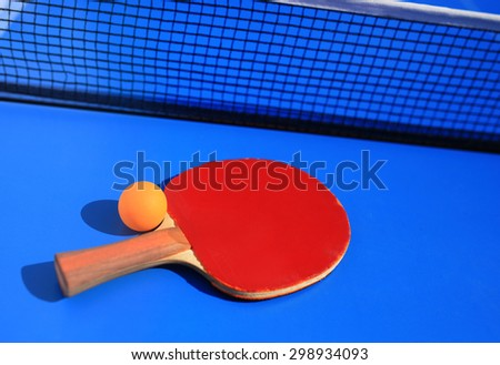 Table tennis equipment racket, ball and net - stock photo