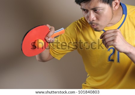 Table Tennis man hit Ping-Pong ball - stock photo