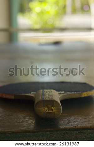 table tennis paddle in outdoor cabana - stock photo