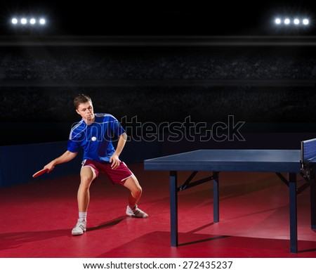 Table tennis player at sports hall - stock photo