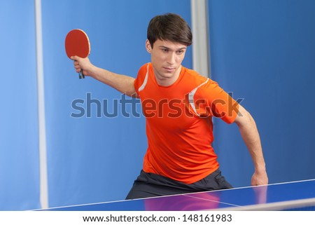 Table tennis player. Confident young men playing table tennis - stock photo
