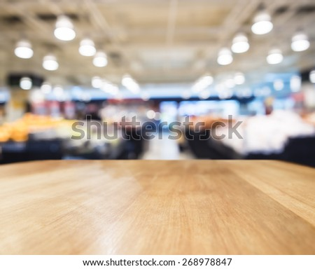 Table top counter Bar with Blurred Supermarket Interior background - stock photo