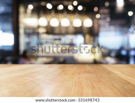 Table top with Blurred Bar restaurant cafe interior background - stock photo
