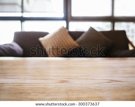 Table top with Sofa and Pillows Home Interior decoration - stock photo