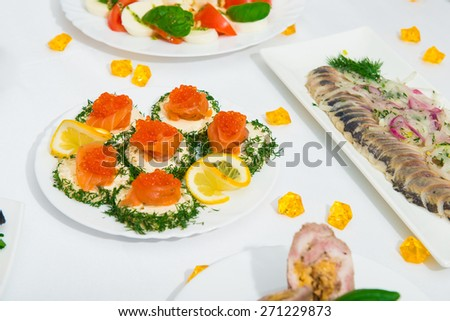 table with a plate of sandwiches. Beautiful sliced food arrangement.  - stock photo