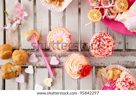 Table with all kinds of sweets as the party is in progress - stock photo