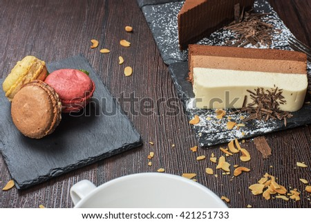 Table with cakes ans coffee cup - stock photo